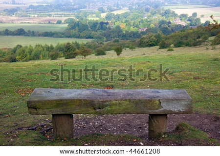 A wooden bench with a beautiful viewpoint over English countryside near to the town of Watlington in Oxfordshire.