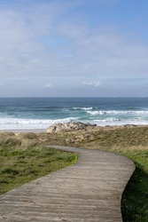 A wooden path that gives access to the dunes in Corrubedo, Spain.