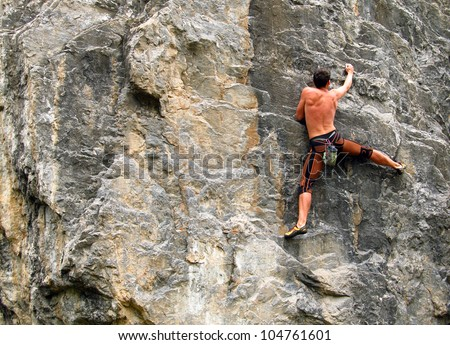 A young climber on the wall.