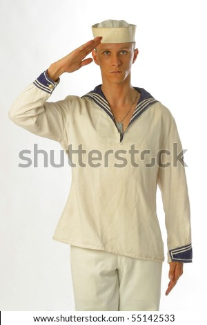 A young sailor man poses in the studio