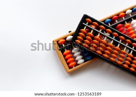 Abacus for mental arithmetic on a white background. Quickly count on abacus. Soroban. Rule bills and hand gestures