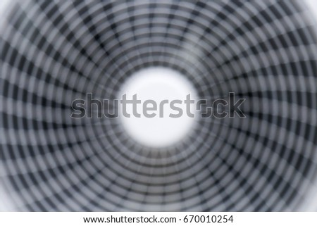Abstract Blurred background : closeup fan air conditioning compressor working outdoor unit