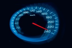 Abstract Speedometer scoring high speed in a fast motion blur.