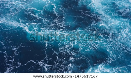 Abstraction of sea foam in the ocean. Dark water, storm waves