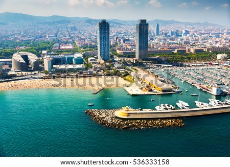 aerial view of docked yachts in Port. Barcelona, Spain\r