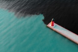 Aerial view of lighthouse. Industrial water pollution. Pier Head Light in  Milwaukee, Wisconsin, USA.  Ocean, sea, bay.