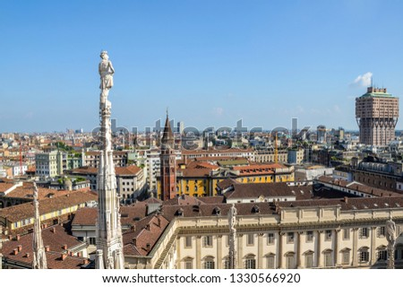Aerial view of Milan from Duomo roof terrace, Italy. Visible Tower Velasca and Bell Tower in Saint Gottardo in Corte, Italy