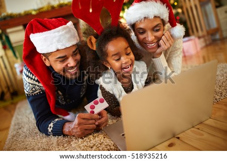afro African family realize Christmas shopping online from warm living room at home