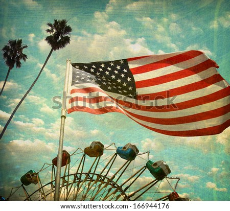 aged and worn vintage photo of american flag with ferris wheel and palm trees