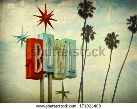 aged and worn vintage photo of bowling alley sign and palm trees