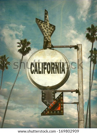 aged and worn vintage photo of  california sign with palm trees