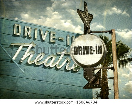 aged and worn vintage photo of  drive in movies sign