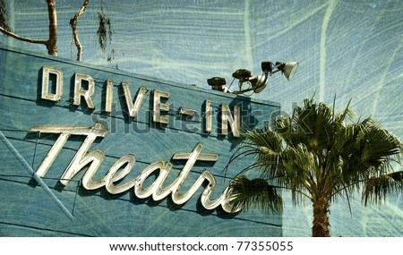 aged and worn vintage photo  of drive in theater