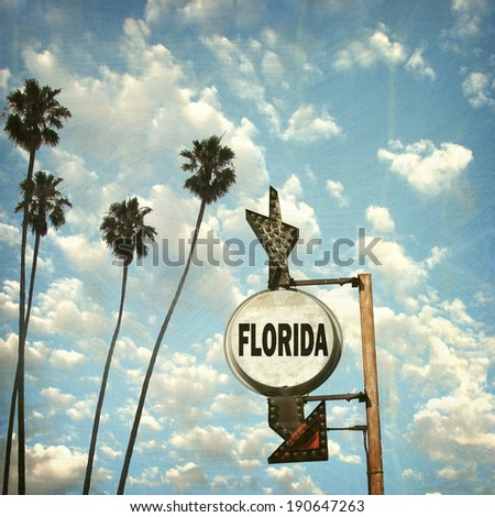 aged and worn vintage photo of Florida sign with palm trees