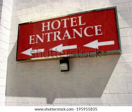 aged and worn vintage photo of  hotel entrance sign with arrows