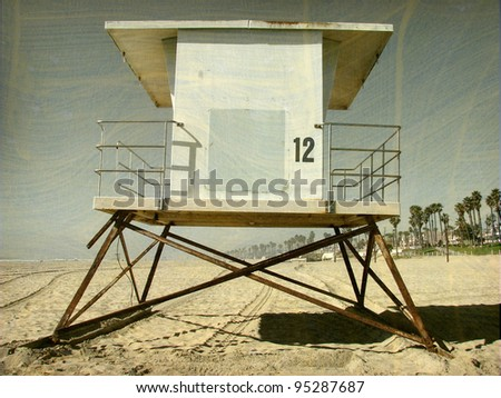 aged and worn vintage photo of lifeguard tower