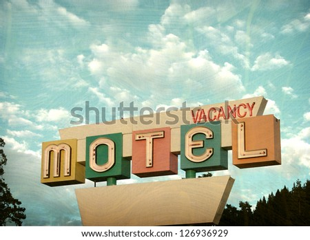 aged and worn vintage photo of motel vacancy sign