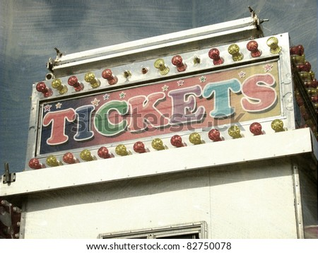 aged and worn vintage photo of ticket booth at carnival