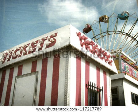 aged and worn vintage photo of ticket booth with ferris wheel