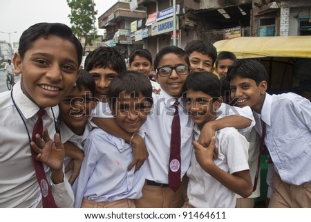 AHMEDABAD, INDIA - SEPTEMBER 7: Unidentified children in school uniforms at September 7, 2011 in Ahmedabad, India. Education has been made free for children for 6 to 14 years of age in India. - stock photo