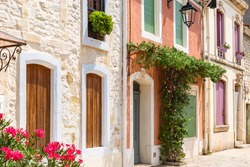 Aigues-Mortes in the south of France, typical colorful houses in the village