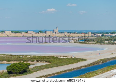 Aigues-Mortes, Salins du Midi, panorama with pink lake and Aigues-Mortes in background
