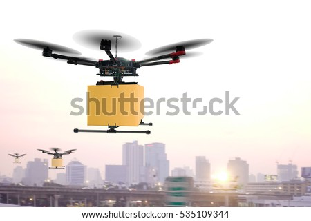 Air drones carrying cardboard box in sunset sky the concept image of futuristic delivery drone.