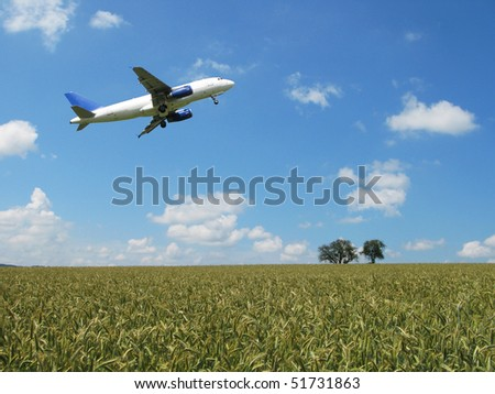 Aircraft taking off over a scenic wheat field #51731863