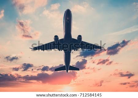 airplane on sunset sky   ...