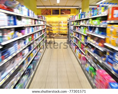 aisle of a supermarket with blurred motion - stock photo