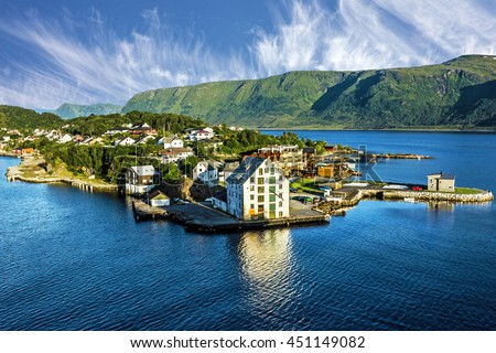 Alesund, Norway. Sea view on houses on the island in summer, Norwegian fjords landscape, travel background