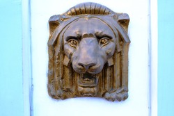 03.30.2021 Almaty, Kazakhstan. Bronze sculpture of a lion on the wall.