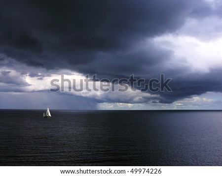 Alone white little yacht in sea with storm weather