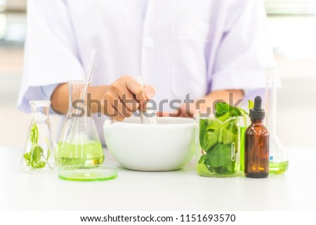 Alternative organic herbal drug and chemical medicine, Doctor mixing extraction for new pharmacy formulation,Innovative technologies in science and medicine. Stock photo ©