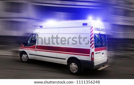 ambulance car on blured background. Ambulance auto paramedic emergency.