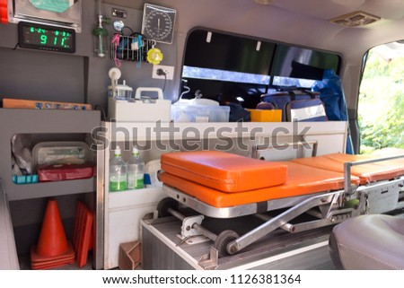 Ambulance stretcher and Life saving equipment  inside the ambulance, rescue concept.   #1126381364