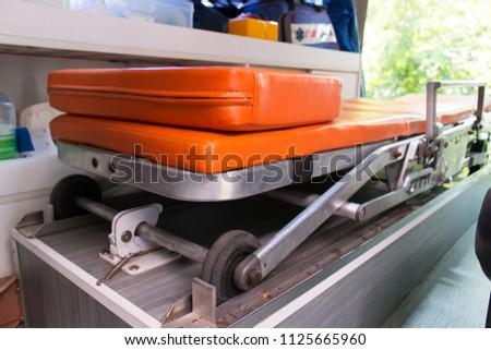 Ambulance stretcher  inside the ambulance, rescue concept.  #1125665960