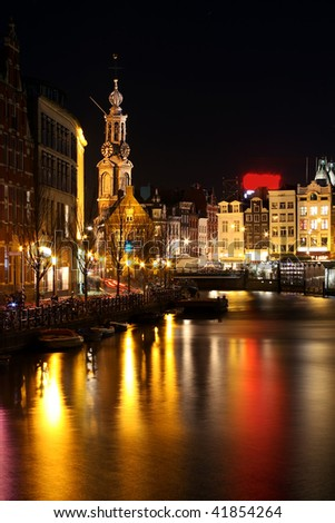 Amsterdam inner city by night with the Munttower in the Netherlands