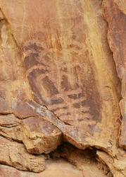 an  ancient native american petroglyph in the three fingers canyon in the san rafael swell near green river, utah