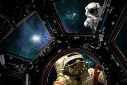 An astronaut tries to warn a cosmonaut about an approaching gamma ray burst approaching the space station. - Elements of this image courtesy of NASA