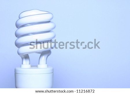- an energy saving light bulb with room for text; shot in a light tent; blue toning derives from white balance setting \