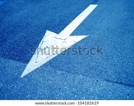an image of an arrow on the road