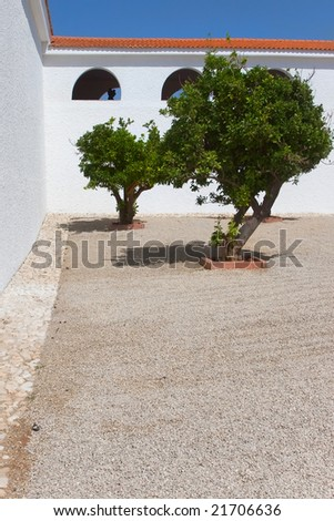 An internal court yard in the Spanish style - a patio and trees