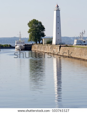 An old white lighthouse on the Baltic coast