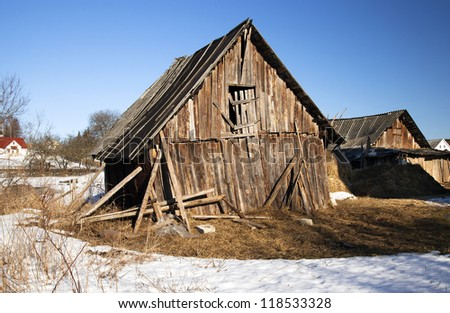an old wooden shed which started to fall sideways. Belarus