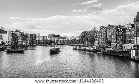 Сanal and embankments of Amsterdam city. Black-white photo.