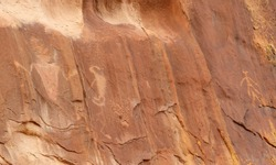 ancient native american humanoid petroglyphs of three fingers canyon in the san rafael swell,  from the fremont and barrier canyon periods, near green river, utah