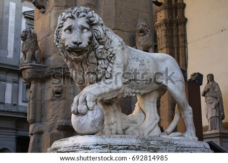 ancient statue of a lion in...