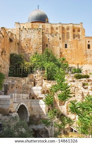 """Ancient walls of Jerusalem and a dome of a mosque """"Al- Aqsa"""" - stock photo"""