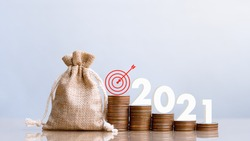 2021 and Coins stack. Pension fund, 401K, Passive income. Investment and retirement. Business investment growth concept. Risk management. Budget 2021.